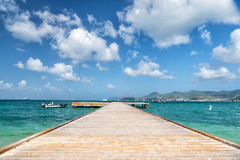 Marine harbour with pathway dock. Beautiful marine dock with wooden pathway harbour and boats transport on water sunny summer outdoor on cloudy blue sky Stock Photo