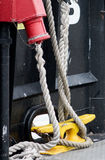 Marine Hardware. Dock lines are secured to this cleat on the ferry Royalty Free Stock Photo
