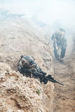 Marine Infantry Parachute Regiment. Squad of elite french paratroopers of 1st Marine Infantry Parachute Regiment RPIMA in action in enemy trenches filled with Stock Photography
