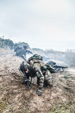Marine Infantry Parachute Regiment. Squad of elite french paratroopers of 1st Marine Infantry Parachute Regiment RPIMA in action in enemy trenches one militant Royalty Free Stock Photos
