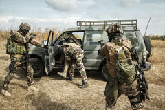 Marine Infantry Parachute Regiment. Squad of elite french paratroopers of 1st Marine Infantry Parachute Regiment RPIMA detaining terrorist in the car Royalty Free Stock Photography