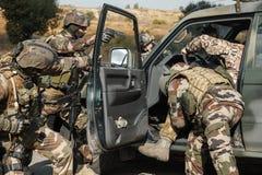 Marine Infantry Parachute Regiment. Squad of elite french paratroopers of 1st Marine Infantry Parachute Regiment RPIMA detaining terrorist in the car Stock Images