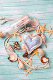 Marine items and decorative heart on turquiose wooden background Stock Image