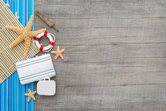 Marine items on wooden background Stock Photos