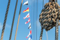 Marine knot, ropes, signal flags Royalty Free Stock Photography