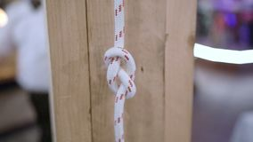 Marine knot on a wooden background stock video