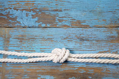 Marine knot on wooden background Royalty Free Stock Image