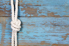 Marine knot on wooden background Stock Photos