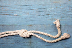 Marine knot on wooden background Royalty Free Stock Photo