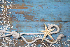 Marine knot on wooden background Royalty Free Stock Images