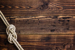 Marine knot on wooden deck Royalty Free Stock Photos