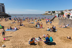 Marine lake beach Weston-super-Mare Somerset in August summer sunshine with tourists and visitors Royalty Free Stock Photo