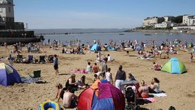Marine Lake beach Weston-super-Mare Somerset in summer with people PAN stock video