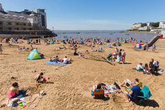 Marine lake beach Weston-super-Mare Somerset in summer sunshine with tourists and visitors. Beautiful summer sunshine and warm weather drew visitors to the Stock Photo