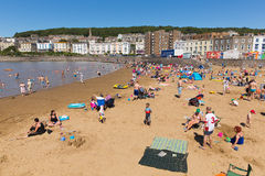 Marine lake beach Weston-super-Mare Somerset in summer sunshine with tourists and visitors. Beautiful summer sunshine and warm weather drew visitors to the Royalty Free Stock Photography
