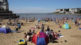 Marine Lake beach Weston-super-Mare Somerset in summer with visitors and holidaymakers stock video