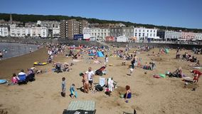 Marine Lake beach Weston-super-Mare Somerset in summer with visitors and holidaymakers PAN stock video