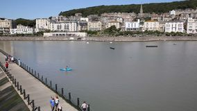Marine lake Weston-super-Mare Somerset in summer sunshine with tourists and visitors PAN stock video