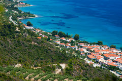 Marine landscape. Greece, Kassandra, Chalkidiki. Blue sea and sky, small town with red roofs royalty free stock photography