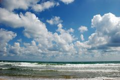Marine landscape. With white clouds and small waves Stock Photo