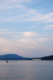 Marine landscape with a ferry and a small boat Stock Photography