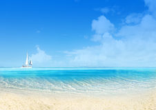 Marine landscape with sailing boat. White sand beach and blue sky. Tranquil scene Stock Photo