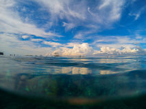 Marine landscape with transparent water and blue sky. Natural water background. Stock Photos