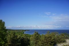 Marine landscape with views of a small village surrounded by forests on the Curonian spit. In Russia royalty free stock photos