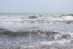 Marine landscape. Marine waves are broken over a bank Royalty Free Stock Photography