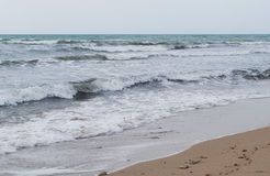 Marine landscape. Marine waves are broken over a bank Royalty Free Stock Photos