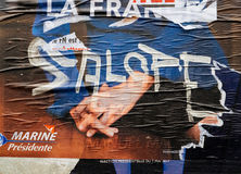 Marine Le Pen vandalized poster second voting round France presi Stock Images