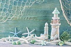 Marine life decoration. On a green shabby background Stock Photography