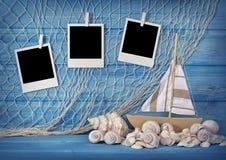 Marine life decoration. And instant photos on blue shabby background Stock Images