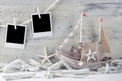 Marine life decoration. And  instant photos on a white shabby background Stock Image