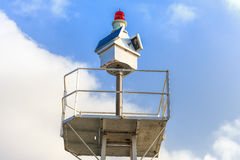 Marine Light. At the entrance of a small village marina royalty free stock images