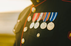 Marine Medals in Sunlight. A marine in his dress uniform with his medals shining in the sunlight Stock Photo