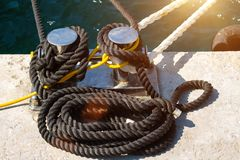 Marine mooring cable on the pier royalty free stock photography