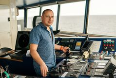 Marine navigational officer or chief mate on navigation watch. On ship or vessel royalty free stock photo