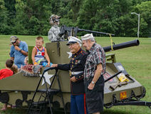 Marine and Navy veterans. Salem, VA – July 27th: Marine and Navy war II veterans posing with a child at the 8th Annual Touch-A-Truck in Greenhill Park, Salem Royalty Free Stock Photos