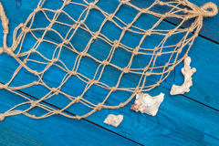 Marine Network and shells on blue boards Stock Photo
