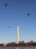 Marine One & Escort Fly By Washington Monument en route to White House Royalty Free Stock Photos