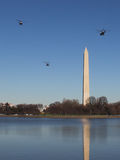 Marine One & Escort Fly By Washington Monument en route to White House Stock Image
