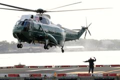 Marine One VH-3D landing on Wall Street Heliport stock images