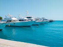 Marine parking of beautiful yachts and boats on clear calm water in Egypt. Travel and tourism concept. stock photo