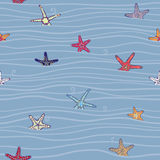 Marine pattern with starfish and waves Royalty Free Stock Photo
