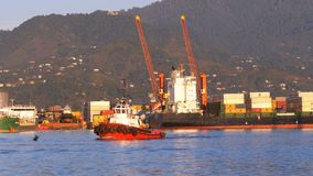 Marine Port of Batumi with Cranes, barges and ships in the sea against the backdrop of the mountains. BATUMI, GEORGIA, OCTOBER 29, 2018: Marine Port of Batumi stock footage