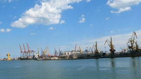 Marine port cranes, and industrial zone in cargo front of Odessa sea commercial port in Ukraine. Logistic freight center stock video footage