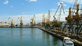 Marine port cranes, and industrial zone in cargo front of Odessa sea commercial port in Ukraine. Logistic freight center stock video
