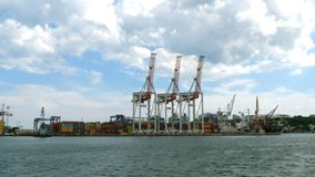 Marine port cranes, and industrial zone in cargo front of Odessa sea commercial port in Ukraine. Logistic freight center. View from the sea stock footage