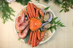 Marine products helping of various kinds of dishes. I served an abalone, a deep red snow crab, red prawns to a colander Royalty Free Stock Photography